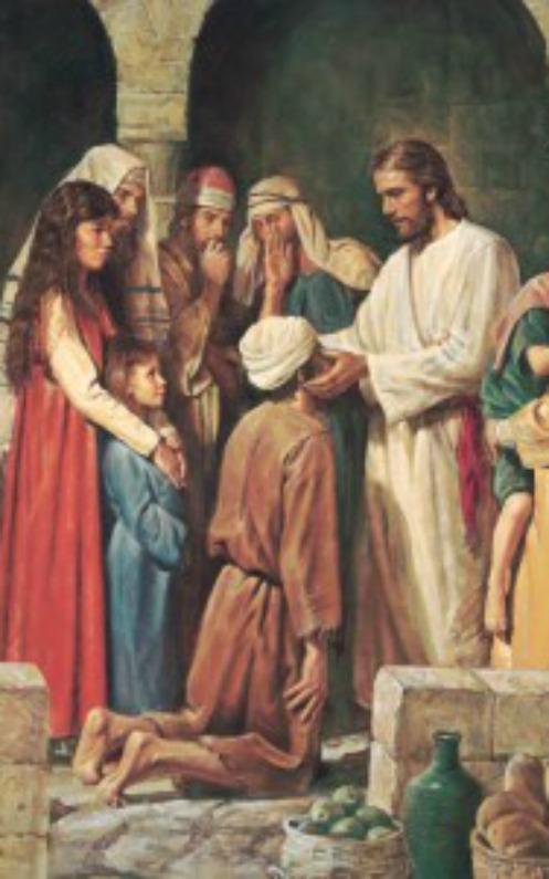 盲目の人に手をおいて癒すキリスト