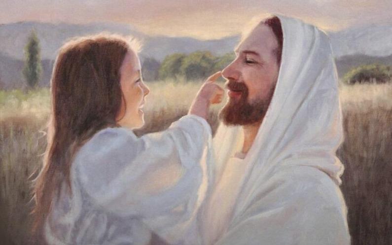 女の子がイエス様の鼻を指す